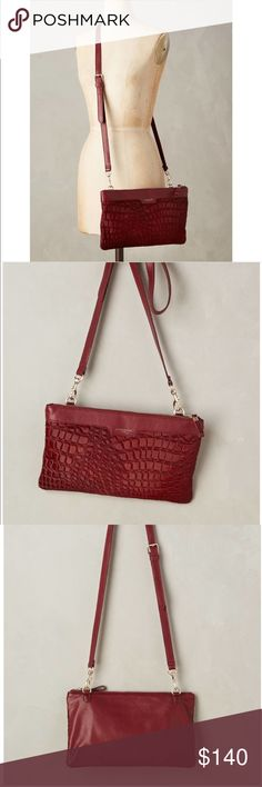 "LIEBESKIND BERLIN - CAROL EMBOSSED CROSSBODY BAG This is a red leather crossbody bag by Liebeskind Berlin.  It's a gorgeous red wine color with a hair embossed croc pattern on the front. It has an adjustable strap with goldtone hardware. The strap can also be removed to carry it as a clutch. It has ""Liebeskind Berlin"" embossed in gold letters on the top leather trim. Inside are several pockets including a zippered one.   Gently used.  There is one hardly noticeable scuff on the trim- shown…"