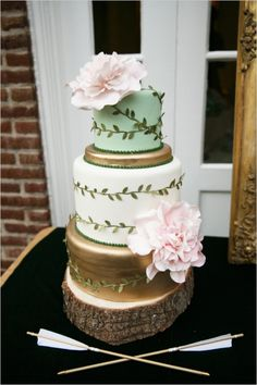 gold white and mint vine wrapped wedding cake #weddingcake #elegantcake #weddingchicks http://www.weddingchicks.com/2014/04/09/english-garden-wedding-ideas/