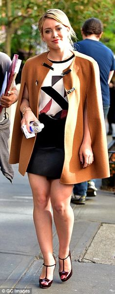 City chic: The Lizzie McGuire star paired her wrap-over thigh-skimming skirt with a graphi...