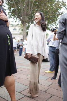 They Are Wearing: Milan Fashion Week - Slideshow  favorite look:  coolest pants ever, cozy sweater and lovely clutch