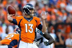 Trevor Siemian Photos Photos - Quarterback Trevor Siemian #13 of the Denver Broncos throws the ball in the first quarter against the Carolina Panthers at Sports Authority Field at Mile High on September 8, 2016 in Denver, Colorado. - Carolina Panthers v Denver Broncos