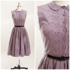 1950s vintage day dress. Made of a dusty lavender cotton. Fitted waist and sleeveless bodice. Shirtwaist style, with matching plastic buttons