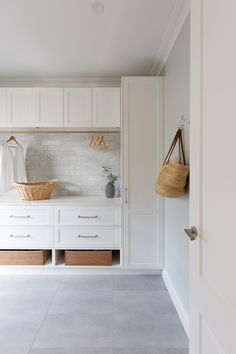 A well designed laundry has a space for everything. Marble subway tiles, white shaker cabinetry, baskets for shoes and hanging space for clothes to dry. Built by Realm Building. Mudroom Laundry Room, Laundry Room Layouts, Laundry Room Organization, Laundry In Bathroom, Small Laundry, Momo Design, Küchen Design, House Design, Design Ideas