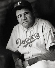 """June 18, 1938 – Hall of Fame slugger Babe Ruth signs a contract to coach with the Brooklyn Dodgers. """"The Babe"""" dons a Dodger uniform the next day, entertains observers with a batting demonstration and works the first-base coaching box. Ruth wore uniform No. 35 and the Dodger coaching position was the last job of Ruth's baseball career."""