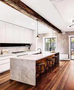 A stand out feature of this #Prahran Art Deco house is the original Tasmanian oak floorboards that compliments the Carrara marble surfaces used within the kitchen space.