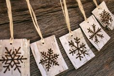 idea for wood burning: A lovely and rustic set of 5 birch bark gift tags which have snowflake designs burnt by hand into the bark with a process known as pyrography, commonly known as woodburning.