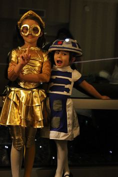 Cute DIY Star Wars costumes + I spy an LED light! Nice use of that for R2-D2, bravo.
