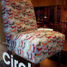 Stealth photo of the ~$700 dachshund chair I took while passing circle furniture today!