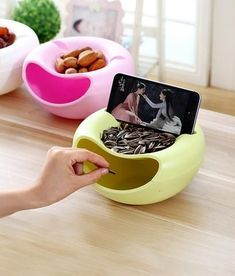 A snack box to hold your phone when you watching a movie and want something to eat