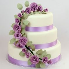 Lilac Roses 3 Tier Cake: Handmade sugar roses. May be made as vanilla sponge with strawberry jam & vanilla butter cream or as fruit cake laced with brandy! / http://elegant-cakes.co.uk/cascading-roses-wedding-cake/