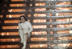 Carrie Fisher in deep thoughts on the stair of the Bespin freeze chamber set.