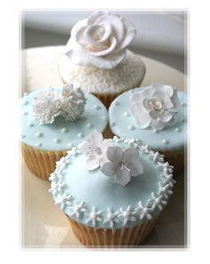 Pretty Pale Blue Icing Cupcakes With Sugar Flowers
