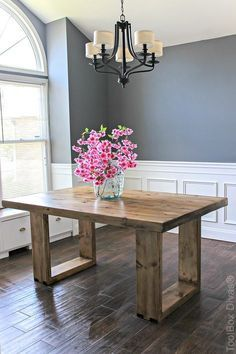 How to build a DIY husky modern dining table for $100! Modern and stylish, this dining table is sure to impress your dinner guests. Plans by Jen Woodhouse.