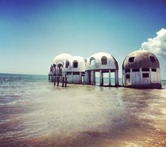 Built in Naples, Florida in 1981, the futuristic igloos seen above may not be around much longer. Falling into disrepair, one dome home owner seeking to restore the vintage vestibule has encountered nothing but exorbitant fines and bureaucratic hassles in the process.
