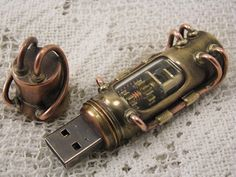 This steampunk styled USB drive is made with brass, copper, glass and a quartz crystal. The metal connections are brazed with silver. This piece