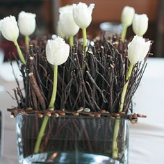 Simple centerpieces of birch twigs and tulips, arranged in square glass vases, complemented the rustic feel of late winter wedding. Twig Centerpieces, Winter Wedding Centerpieces, Wedding Decorations, Wedding Ideas, White Tulips, White Flowers, Flowers Vase, Winter Wedding Receptions, Winter Weddings