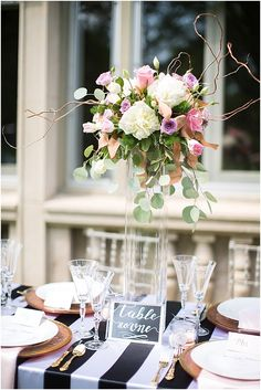 Elevated wedding table flowers | Image by Poly Mendes Photography, see more http://www.frenchweddingstyle.com/pretty-parisian-wedding-inspiration/