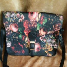 Black flowered rose leather look shoulder purse Brand new flowered print shoulder. purse. Brand new and never used.It measures 10 inches across and 8 inches down Bags Shoulder Bags
