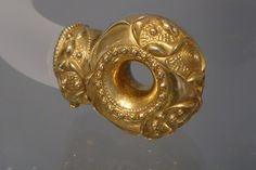 Gold Torc Terminal |   with  late  Celtic  ornamentation,Peeblesshire,Scotland