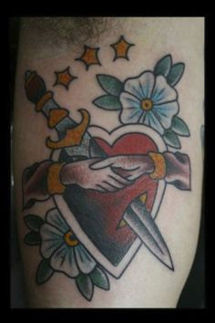 Traditional tattoo by Andy Northup   | All Star Tattoo 8601 Olive Blvd, University City MO 63132 (314) 692-7827 #traditionaltattoo #claddagh #heart #flowers #allstartattoo