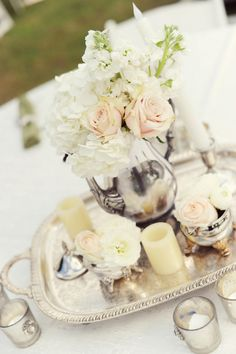 Vintage silver pieces were used as centerpiece containers.  Flowers by Finishing Touch