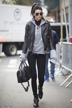 Kendall Jenner wearing Givenchy Lucrezia Bag, Saint Laurent Wyatt 40 Concho Harness Ankle Boots, Saint Laurent Motorcycle Jacket, Saint Laurent Classic 11 Aviator Sunglasses, Unravel Oversized Cashmere Hoodie and Paige Margot Jeans in Black Shadow