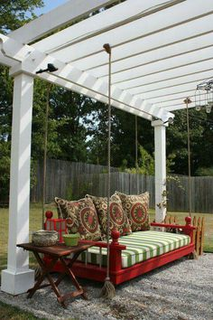 """""""bed"""" suspended from pergola.  Beautiful."""