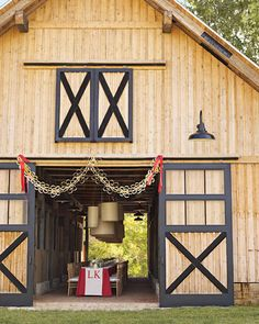 our wedding, one long table thru the barn and round tables in the stalls!   The reception barn is festooned with a garland made from strips of maple veneer as well as biodegradable and vintage ribbons.