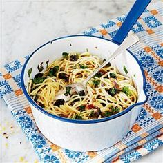 Spaghetti with chunky tapenade. This storecupboard supper combined the robust flavours of anchovies, capers and black olives. For a variation, toss cherry tomatoes and pine nuts through the pasta.