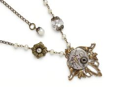 Steampunk necklace antique silver Elgin watch movement gears crystal genuine Pearls gold Victorian flower leaf motif  #SteampunkNecklace #SteampunkJewelry #SteampunkJewelrybyMariaSparks