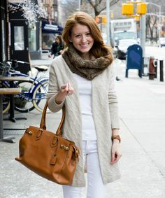 How to style a cashmere cable cardigan with white jeans and riding boots for an unexpectedly chic winter look. White Jeans Outfit, White Outfits, White Pants, Cable Cardigan, Beige Sweater, Designer Boots, Winter Looks, Balenciaga City Bag, Winter White