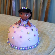Dora princess birthday cake! Made with half of a sphere cake pan and one circle pan. Covered with pink fondants. :)