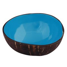 A taste of the tropics! Fashioned from a coconut shell and lined with a bright blue lacquer, this delightful bowl is the next best thing to being on a tropical island. A food safe, Fairly Traded product from artisans with Vietnam's Craft Link. Also available in bright pink, lime green and dark orange.