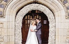 The Bride & Groom standing under an arch of white gypsophila at Sacred Heart Church. Groomswear by Louis Copeland & Sons Reception: Borris House Photography by: Katie Kav Photography Diy Spring Weddings, House Photography, Gypsophila, Formal Dresses, Wedding Dresses, Bride Groom, Sacred Heart, Pretty, Sons