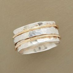 Perfect Partners.  $398.  Hand-Hammered Silver & Gold Spinner Ring                                                Robert Redford's Sundance Catalog