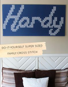 DIY Family Cross-Stitch   This is a wonderful idea.  Cross stitch with yarn on pegboard. Think of the ideas. Design you pattern in Excel!
