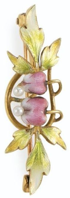 AN ART NOUVEAU ENAMEL AND SEED PEARL BROOCH, LATE 19TH - EARLY 20TH CENTURY. Designed as two pink enamel and pearl bleeding heart flowers, extending green enamel leaves, mounted in gold. 1¼ x 3/8 inches. #ArtNouveau #brooch