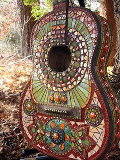 A guitar beyond repair becomes art in the garden... stunning.