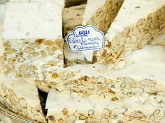 10 Dishes You Must Try In Italy (That Aren't Pizza). TORRONE,  The origins of torrone are somewhat blurry—some say it originated in Lombardy, some insist it was created in Sicily. It doesn't really matter; what's important is that you eat it. It's a creamy, sticky, nougat-like candy made with honey, egg whites, toasted nuts, and citrus zest, sold in thick slabs at cafes and sweet shops across Italy. Normally, we'd say that nothing beats the original, but one modern variation comes dipped in…