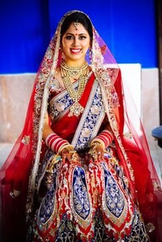 Bridal Lehengas - Blue and red bridal lehenga | WedMeGood #wedmegood #bridal #Lehengas