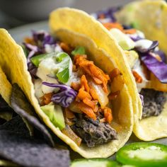 Easy recipe for BBQ pulled carrot tacos with quick re-fried beans and topped with the works. 30 minute vegan, gluten-free meal.