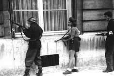 A girl of the resistance movement is a member of a patrol to rout out the Germans snipers still left in areas in Paris, France, on August 29, 1944. The girl had killed two Germans in the Paris Fighting two days previously. (AP Photo) #war #history #WWII
