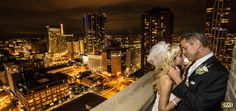 Downtown Wedding Denver Classy Night City Scape Night Lights Yellow Fur Fall Winter Bride and Groom Portrait Balcony Clock Tower Three Tomatos Catering Alan Perry Hollywood Glam