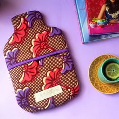 Handmade Hot Water Bottle Cover In A Pink, Violet & Brown African Print Fabric- Gifts Ideas for Mothers Day, Housewarming or Birthday's by JubellaLondon on Etsy African Crafts, African Home Decor, African Textiles, African Fabric, Ankara Bags, African Accessories, Diy Shops, Fabric Gifts, African Print Fashion
