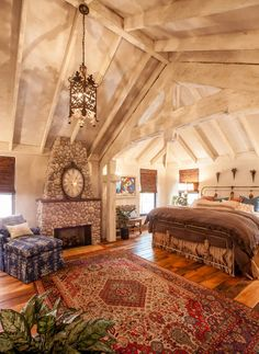 eclectic bohemian bedroom by Key Residential  I would be in heaven if this were my house! The angles! The wood! And a fireplace!