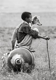 Africa | Boy with a dog sitting on a bomb. Tigray, Ethiopia, 1991 | © Dario Mitidieri
