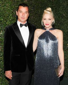 Gavin Rossdale wearing a Ferragamo tailored tuxedo and Gwen Stefani wearing a Resort runway collection metallic beaded fringe gown at the WACPA Inaugural Gala in Beverly Hills.