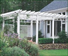 Custom entry pergola that accents the entryway while affording climbing plants the opportunity to flourish. Via Walpole Outdoors.