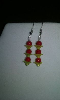 Check out this item in my Etsy shop https://www.etsy.com/listing/513653722/artisan-handmade-red-ceramic-bead-yellow