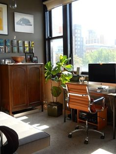 the plant is a nice touch an dI like the storage cabinet - Mike's Penthouse Perch — Small Cool | Apartment Therapy